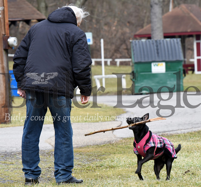 Harold Aughton/Butler Eagle: Isabel, a rescue, Terrier/Black Lab mix, plays fetch with her owner, Bob Harvey, of Butler in Memorial Park, Wednesday, February 12, 2020.