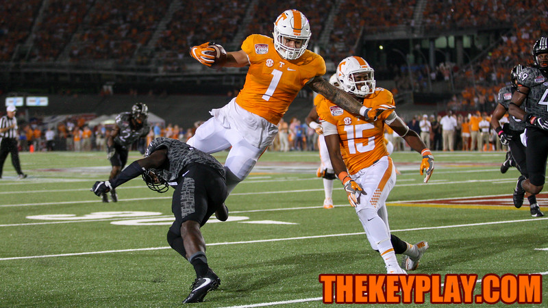 RB Jalen Hurd (1) leaps to avoid a tackle by CB Brandon Facyson. (Mark Umansky/TheKeyPlay.com)