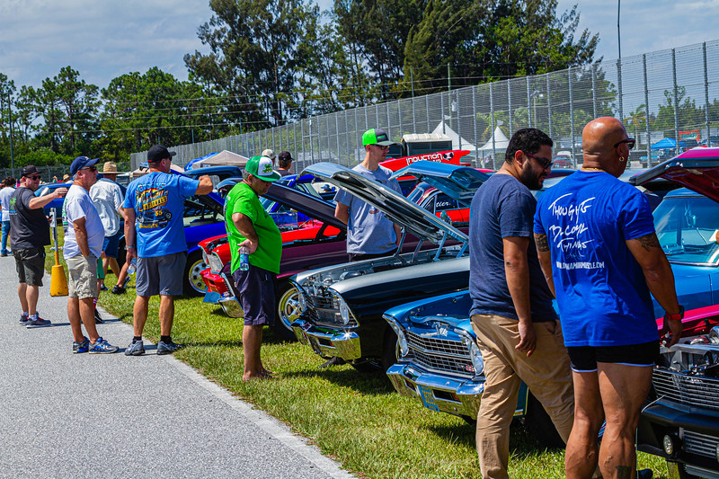 Car enthusiasts admire the line of Chevy El Caminos at Palm Beach International Raceway on Saturday, May 25, 2019. [JOSEPH FORZANO/palmbeachpost.com]