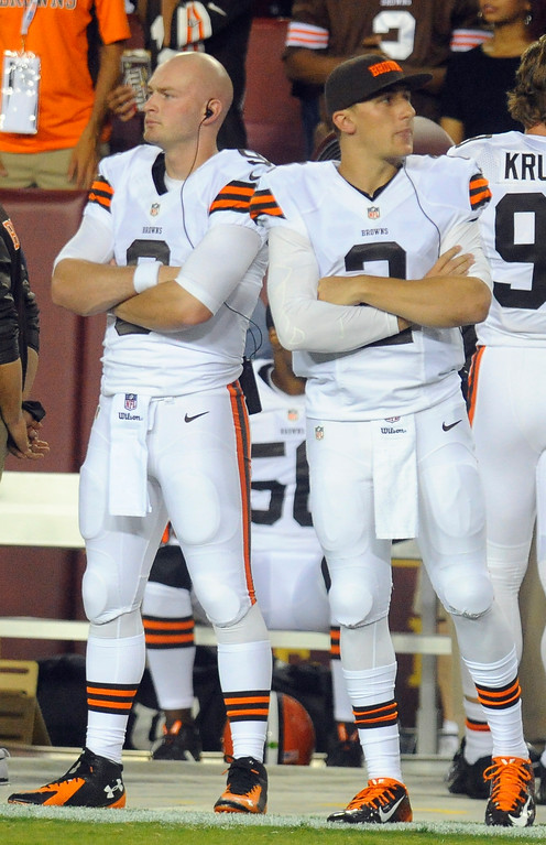 . Associated Press file Cleveland Browns quarterbacks Connor Shaw, left, and Johnny Manziel (2) wait for their time on the field during the first half of an NFL preseason football game against the Washington Redskins Monday, Aug. 18, 2014, in Landover, Md.