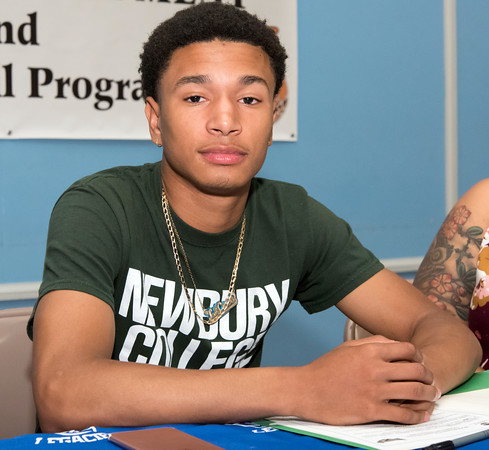 05/25/18 Wesley Bunnell | Staff Basketball standout at E.C. Goodwin High School Francisco Santiago II signed his papers intending to attend and play basketball for Newbury College. The signing took place at St. Matthew's on Friday night.