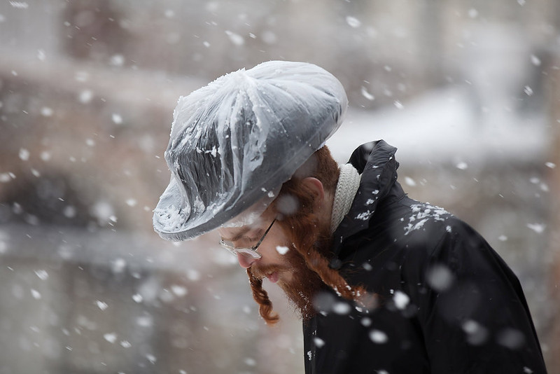. An Ultra-orthodox Jewish man walks in the snow in the Mea Shearim religious neighborhood on January 10, 2013 in Jerusalem, Israel.  (Photo by Uriel Sinai/Getty Images)