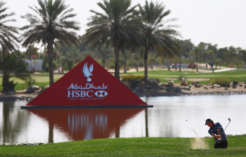 Description of . Jason Dufner of the USA plays out of the bunker on the 9th hole during day one of the Abu Dhabi HSBC Golf Championship at Abu Dhabi Golf Club on January 17, 2013 in Abu Dhabi, United Arab Emirates.  (Photo by Matthew Lewis/Getty Images)