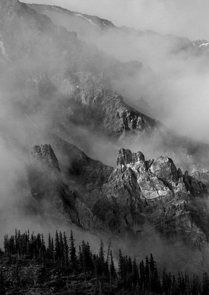 Clouds tatter along rocky crags of the Mt Vulcan massif, in the Yukon's Kluane Mountains. June, 2013.