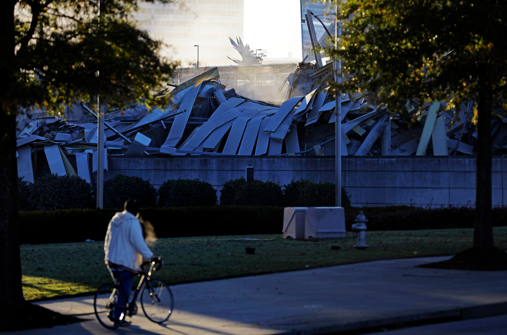 . The falcon sculpture that stands outside Mercedes Benz Stadium, the new home of the Atlanta Falcons, is seen beyond the rubble of the Georgia Dome after it was imploded in Atlanta, Monday, Nov. 20, 2017. The dome was not only the former home of the Atlanta Falcons but also the site of two Super Bowls, 1996 Olympics Games events and NCAA basketball tournaments among other major events. (AP Photo/David Goldman)