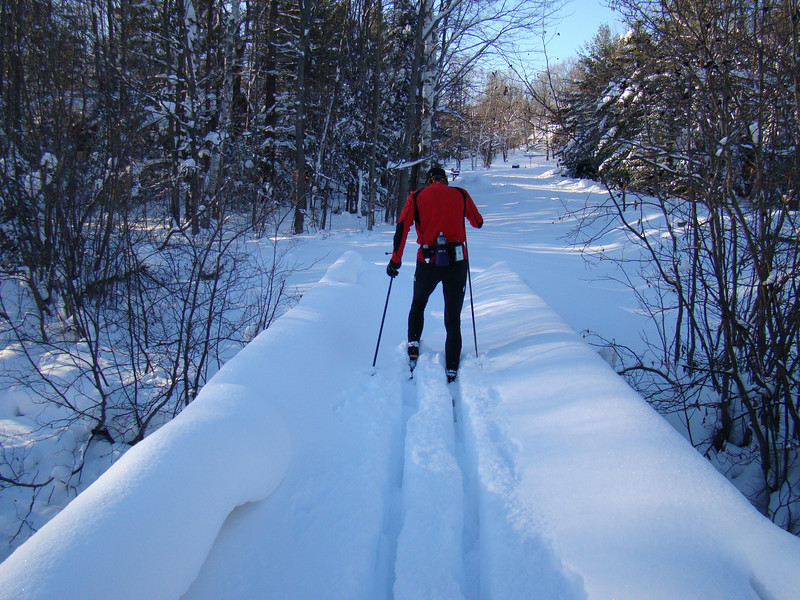 Taking a short cut over the bridge. 18 inches of fresh snow in the last 7 days!