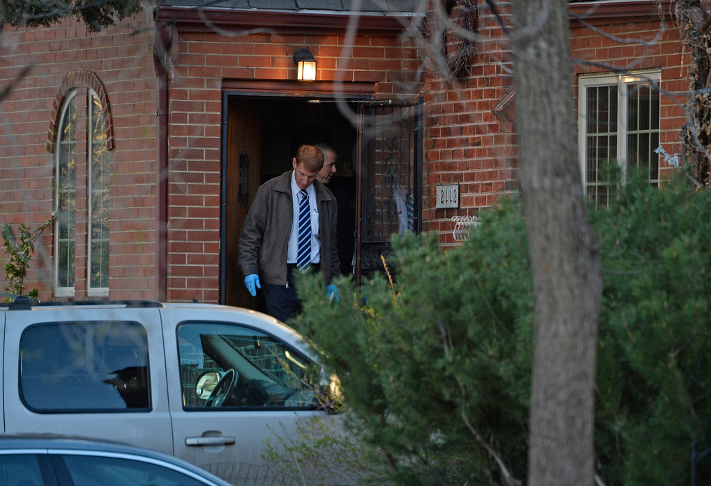 . DENVER, CO - APRIL 15: Denver police investigate a homicide at a home in the 2100 block of South Saint Paul Street in Denver, Tuesday, April 15, 2014. (Photo by RJ Sangosti/The Denver Post)