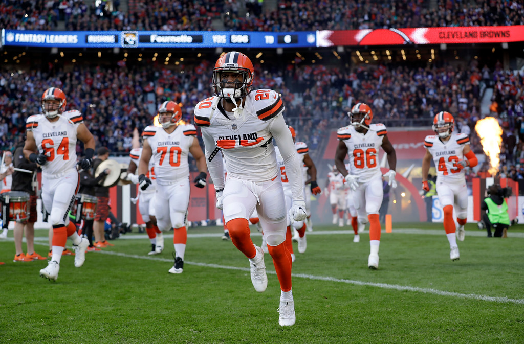 . Cleveland Browns players run onto the field before an NFL football game between the Cleveland Browns and the Minnesota Vikings at Twickenham Stadium in London, Sunday Oct. 29, 2017. (AP Photo/Matt Dunham)