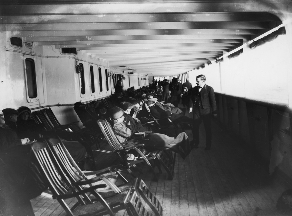 . Passengers relax in deck chairs on the saloon deck of the Cunard liner Lusitania, June 1912. The ship was sunk by a German submarine in 1915.  (Photo by Topical Press Agency/Hulton Archive/Getty Images)