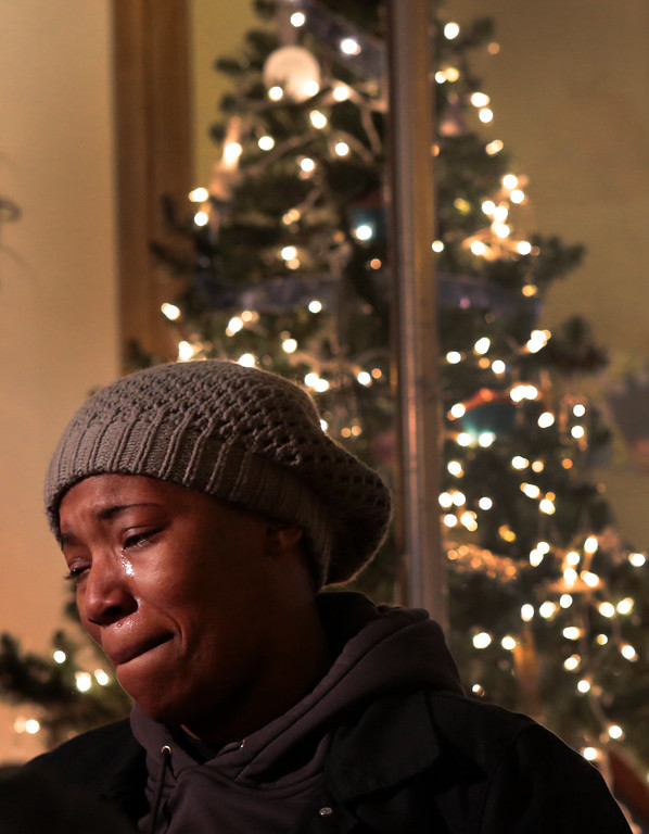 . Natalie DuBose weeps outside her Natalie\'s Cakes and More bakery Monday, Nov. 24, 2014, after vandals broke one of two large windows in her store after a grand jury declined to indict white police officer Darren Wilson in the death of Michael Brown. DuBose\'s bakery is a black-owned business supported by the protesters. (AP Photo/St. Louis Post-Dispatch, Robert Cohen)
