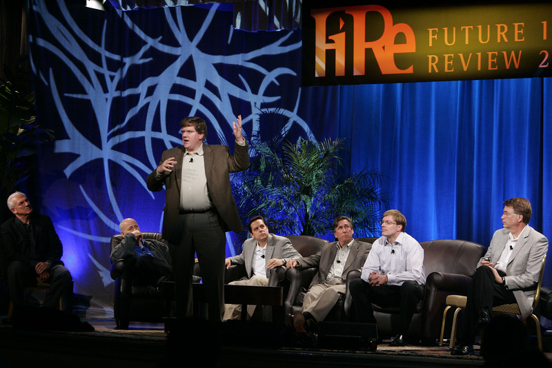 """CTO Design Challenge: """"And the Solution Is--"""": (L-R) Ron Roberts, David Brin, Ty Carlson (presenting), Brian Higbee, Kevin Walter, Kelly Millsaps, and Larry Smarr"""