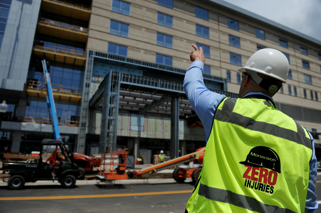 . Bill Gregor, Director of Operations for Mortenson Construction, points to the new Exempla Saint Joseph Hospital, which has been under construction since July, 2011, and will receive its first patient in the new facility mid-December of this year. Over 830,000 square feet of new buildings will accommodate more patients, put roads back on the grid system and reduce costs - including utilities costs by over 40 percent. Photo by Jamie Cotten, Special to The Denver Post