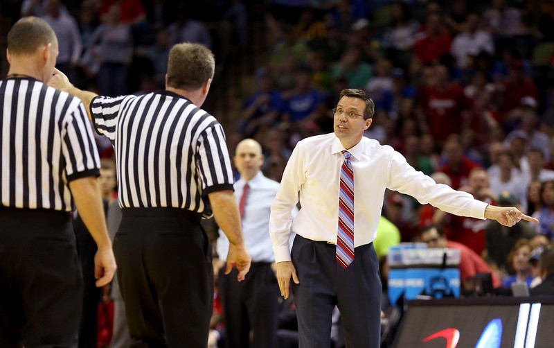 . Head coach Tim Miles of the Nebraska Cornhuskers talks to an official after receiving his second technical foul in the second half against the Baylor Bears during the second round of the 2014 NCAA Men\'s Basketball Tournament at AT&T Center on March 21, 2014 in San Antonio, Texas.  (Photo by Ronald Martinez/Getty Images)