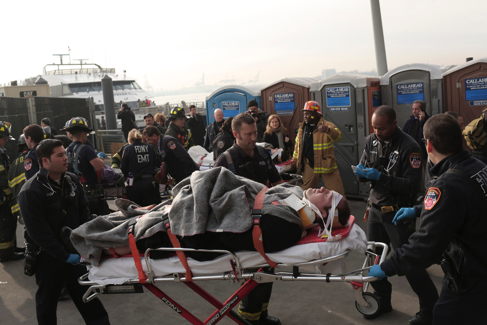 Description of . Emergency personnel assist injured passengers after a ferry crash at Pier 11, at South Street and Gouverneur Lane, in New York, Jan. 9, 2013. The ferry crashed as it was docking in Lower Manhattan Wednesday morning, injuring at least 57 people, according to emergency officials. (Michael Appleton/The New York Times)