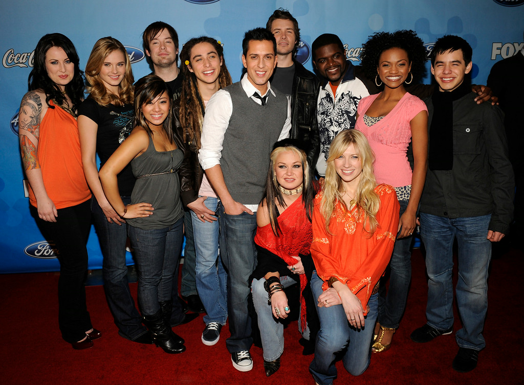 . Contestants, rear left to right, Carly Smithson, Kristy Lee Cook, Ramiele Malubay, David Cook, Jason Castro, David Hernandez, Michael Johns, Chikezie, Syesha Mercado, David Archuleta, and front left to right, Amanda Overmyer and Brooke White attend the American Idol annual Top 12 Party Thursday, March 6, 2008 in West Hollywood, Calif. (AP Photo/Phil McCarten)