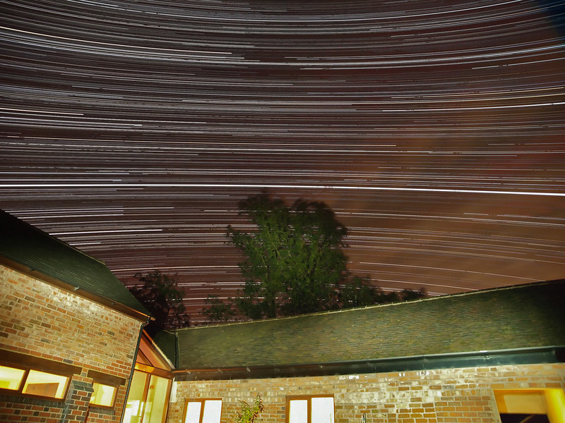 Sept 16_17 2010. Startrail captured with Olympus E3, 12-60mm lens. Well impressed with the newly constructed  dew shield. The camera lens really does stay dry all night. In this shot the camera started at 2200hrs on 16th until 5am the following morning. Note the really bright line across the middle, this is Jupiter as it passes very close to Earth at the moment. The opposite curvature of the trails is due to the stars location above and below the celestial equator.