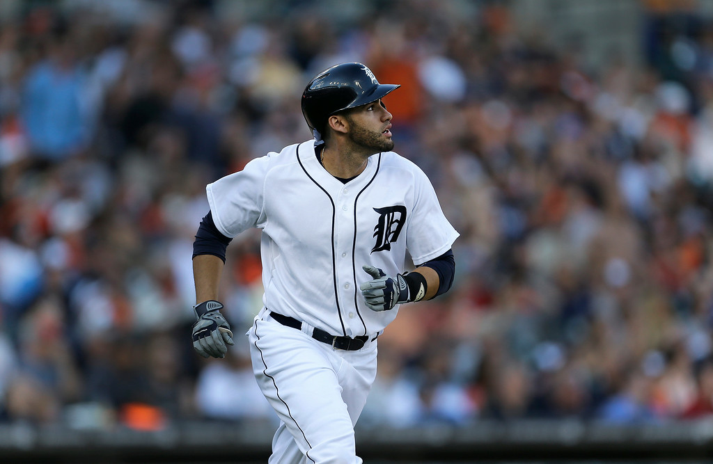 . Detroit Tigers\' J.D. Martinez bats against the Los Angeles Dodgers in the first inning of a baseball game in Detroit, Tuesday, July 8, 2014. (AP Photo/Paul Sancya)