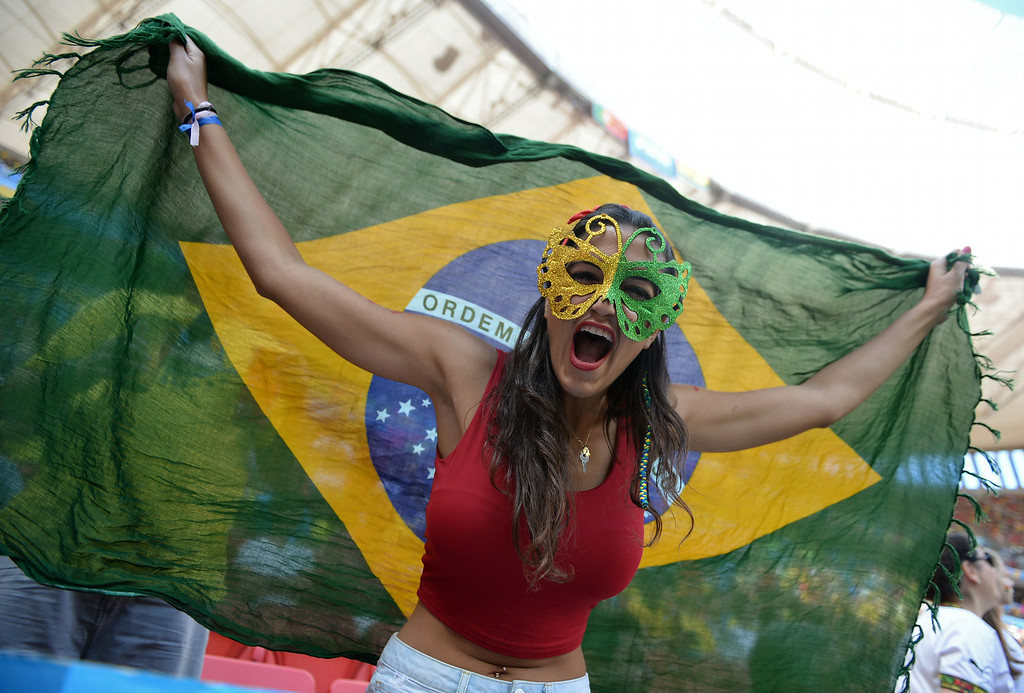 . A fan cheers prior to the Group G football match between Portugal and Ghana at the Mane Garrincha National Stadium in Brasilia during the 2014 FIFA World Cup on June 26, 2014. CARL DE SOUZA/AFP/Getty Images