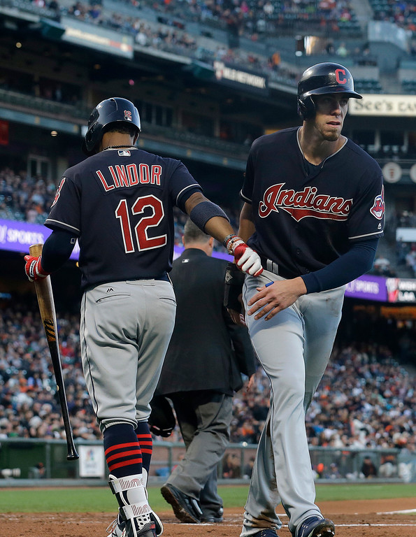 . Cleveland Indians\' Bradley Zimmer, right, is congratulated by Francisco Lindor after scoring against the San Francisco Giants during the third inning of a baseball game in San Francisco, Tuesday, July 18, 2017. (AP Photo/Jeff Chiu)