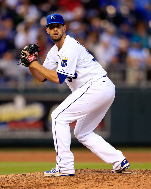 . Starting pitcher James Shields #33 of the Kansas City Royals checks a runner on first during the game at Kauffman Stadium on May 13, 2014 in Kansas City, Missouri.  (Photo by Jamie Squire/Getty Images)