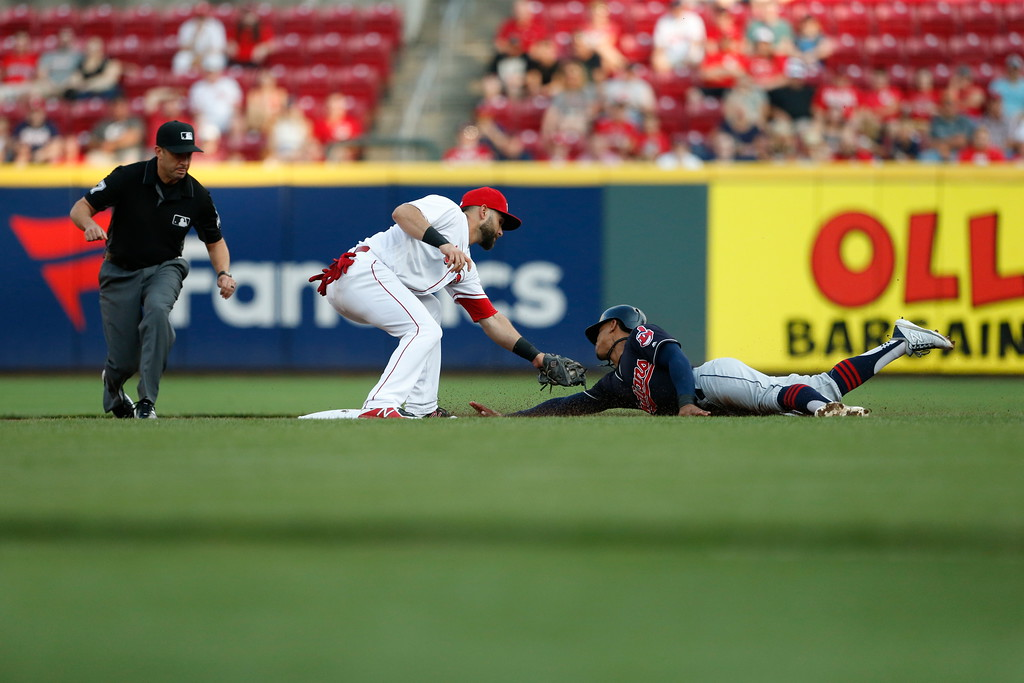 . Cleveland Indians\' Francisco Lindor, right, is tagged out by Cincinnati Reds second baseman Jose Peraza, left, on a steal attempt during the first inning of a baseball game, Monday, Aug. 13, 2018, in Cincinnati. (AP Photo/Gary Landers)
