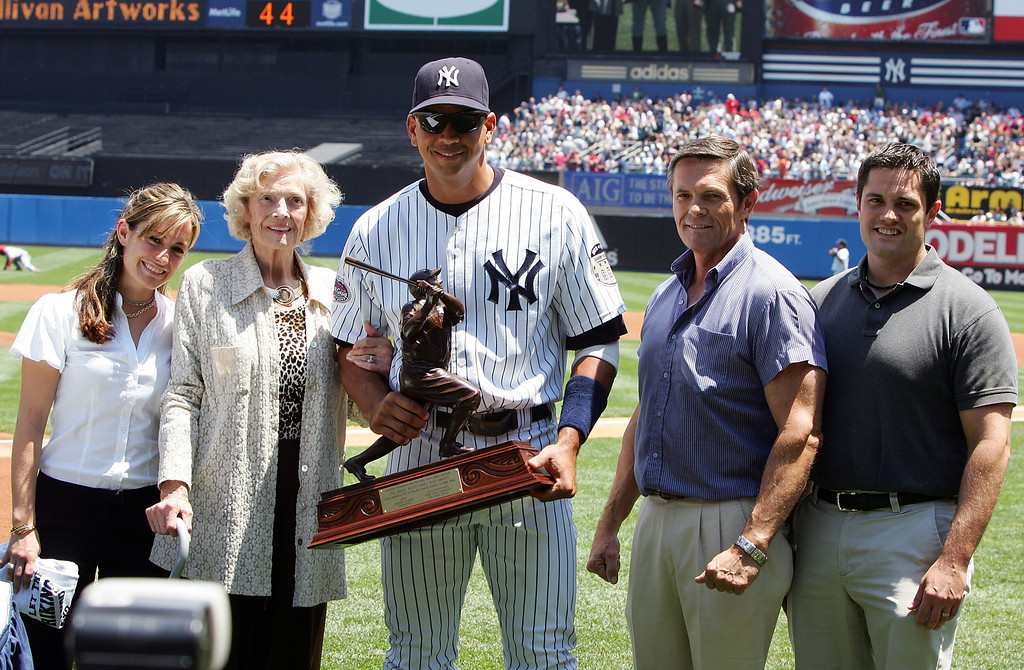 . NEW YORK - JUNE 21:  Alex Rodriguez #13 of the New York Yankees accepts the 2007 Babe Ruth Home Run Award from Julia Ruth Stevens (2nd-L), daughter of Babe Ruth, as grandson Tom Stevens (2nd-R), and great-grandchildren Amanda (L) and Brent Stevens look on prior to the game against the Cincinnati Reds at Yankee Stadium June 21, 2008 in the Bronx borough of New York City.  (Photo by Jim McIsaac/Getty Images)