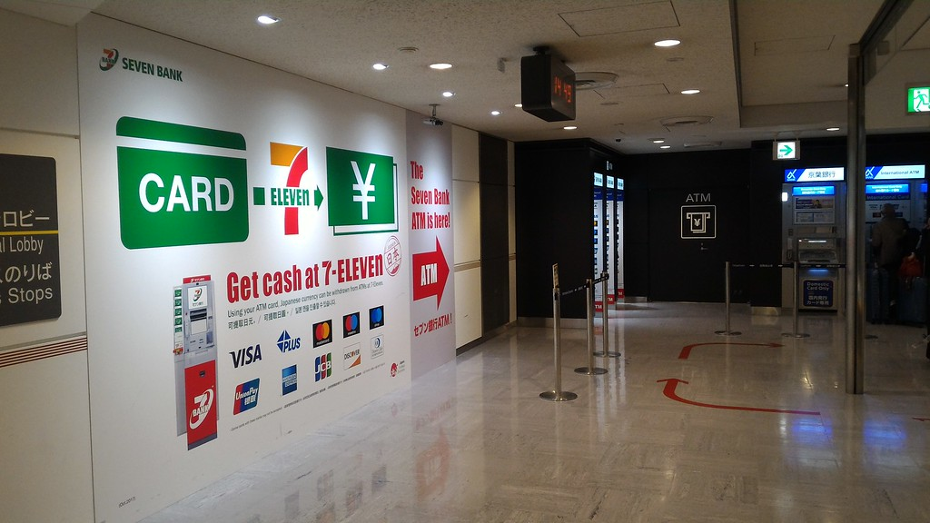 7-11 ATM signs in arrivals hall