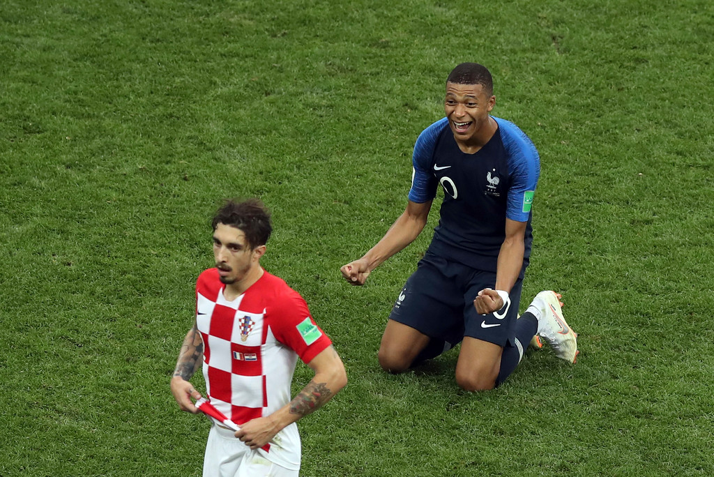 . Croatia\'s Sime Vrsaljko, foreground, reacts as France\'s Kylian Mbappe celebrates at the end of the final match between France and Croatia at the 2018 soccer World Cup in the Luzhniki Stadium in Moscow, Russia, Sunday, July 15, 2018. (AP Photo/Thanassis Stavrakis)