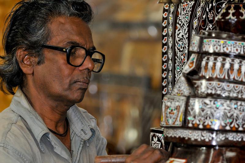 This gentleman is repairing an intricate wood inlay.