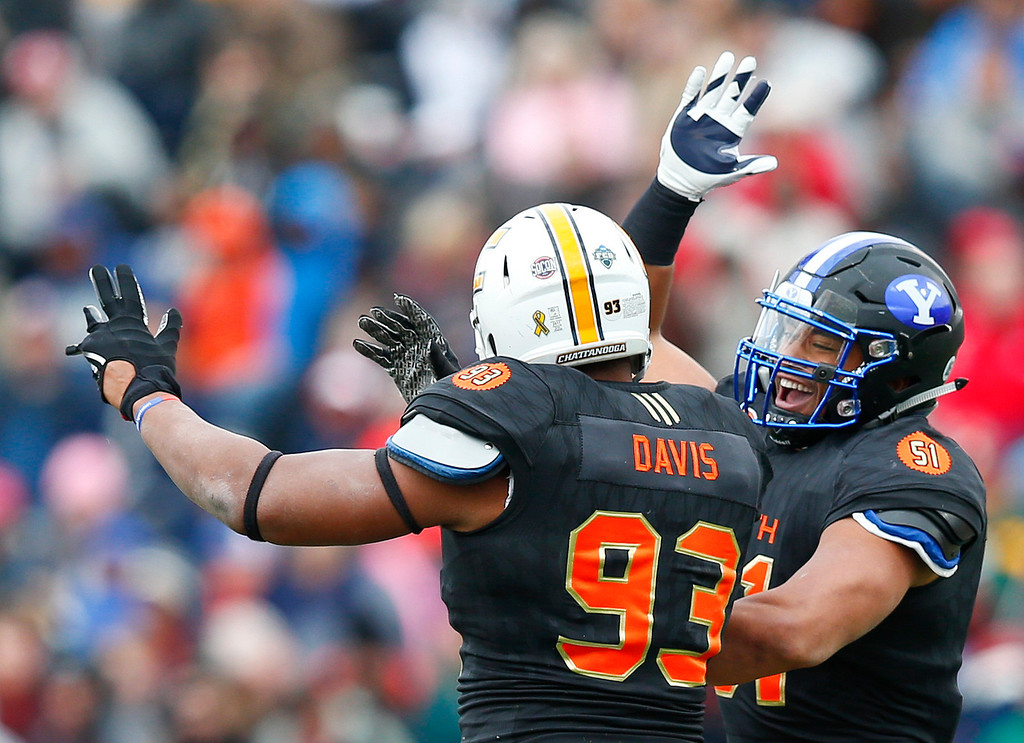 . South squad inside linebacker Harvey Langi of Brigham Young, right, celebrates with South squad defensive end Keionta Davis of UT-Chattanooga, left, after Davis sacks a North squad quarterback during the first half of the Senior Bowl NCAA college football game, Saturday, Jan. 28, 2017, at Ladd�Peebles Stadium, in Mobile, Ala. (AP Photo/Brynn Anderson)