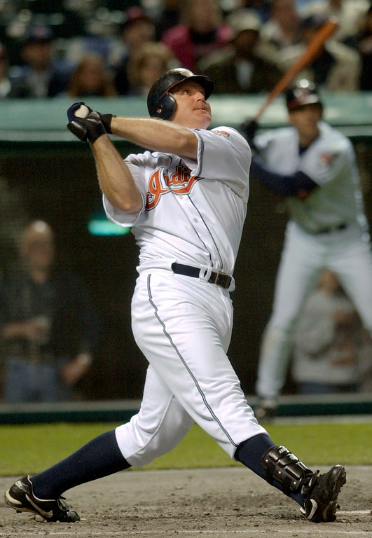 . Cleveland Indians\' Jim Thome smashes a two-run home run off Kansas City Royals pitcher Jeff Suppan in the fourth inning Friday, April 12, 2002, in Cleveland. Indians\' Ellis Burks scored on the play.  (AP Photo/Mark Duncan)