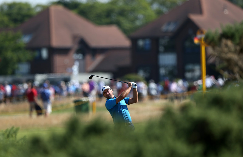. Graeme McDowell of Northern Ireland plays a shot on the 5th hole during the first day of the British Open Golf championship at the Royal Liverpool golf club, Hoylake, England, Thursday July 17, 2014. (AP Photo/Jon Super)
