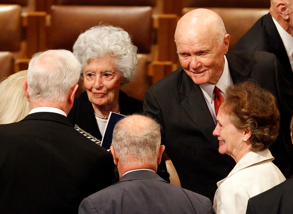 . Astronaut John Glenn, right, and his wife, Annie, greet guests at the Washington National Cathedral in Washington, Thursday, Sept. 13, 2012, following a national memorial service for the first man to walk on the moon, Neil Armstrong. (AP Photo/Ann Heisenfelt)