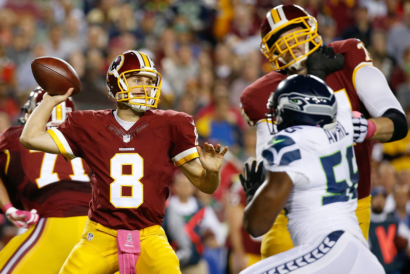 . Washington Redskins quarterback Kirk Cousins (8) passes the ball during the first half of an NFL football game against the Seattle Seahawks in Landover, Md., Monday, Oct. 6, 2014. (AP Photo/Alex Brandon)