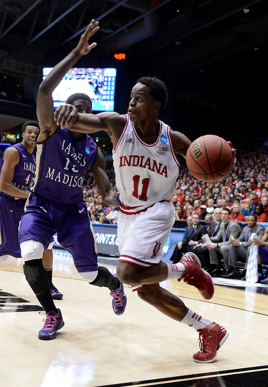 . DAYTON, OH - MARCH 22: Yogi Ferrell #11 of the Indiana Hoosiers handles the ball against Andre Nation #15 of the James Madison Dukes in the first half during the second round of the 2013 NCAA Men\'s Basketball Tournament at UD Arena on March 22, 2013 in Dayton, Ohio.  (Photo by Jason Miller/Getty Images)