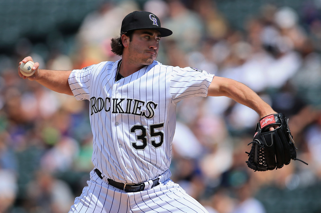 . Starting pitcher Chad Bettis #35 of the Colorado Rockies delivers against the Pittsburgh Pirates at Coors Field on August 11, 2013 in Denver, Colorado.  (Photo by Doug Pensinger/Getty Images)