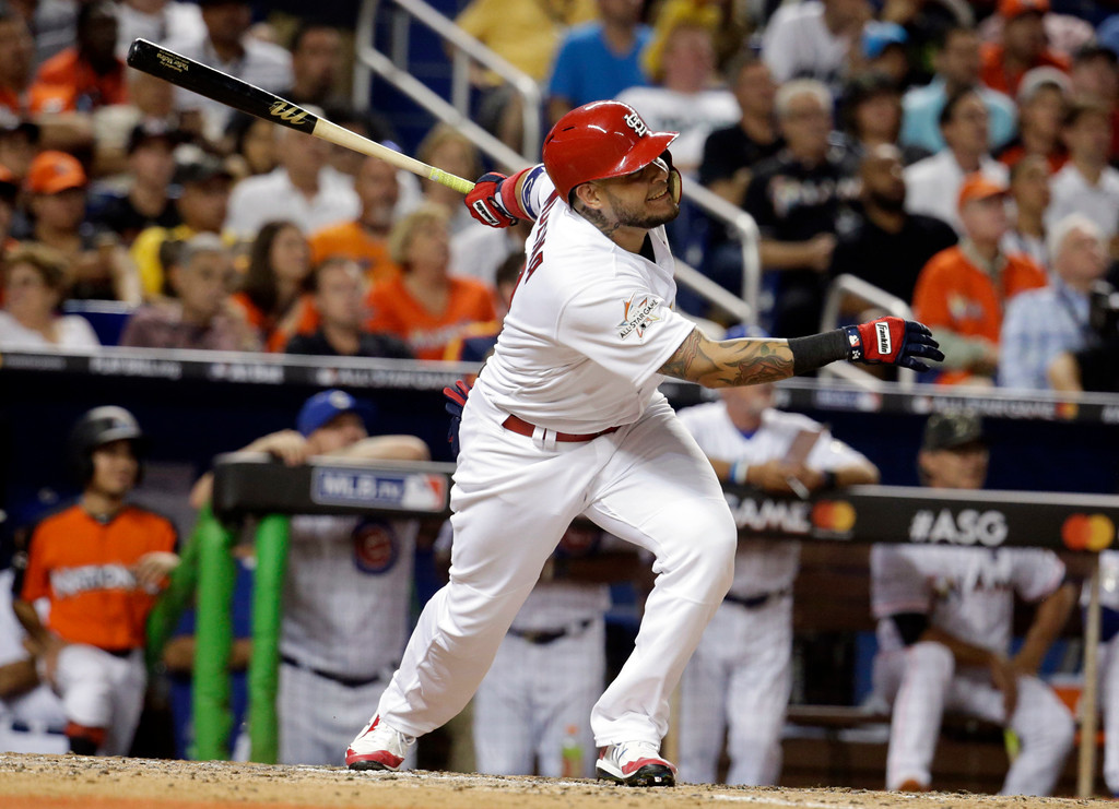 . National League\'s St. Louis Cardinals catcher Yadier Molina (4), hits a homerun in the sixth inning, during the MLB baseball All-Star Game, Tuesday, July 11, 2017, in Miami. (AP Photo/Lynne Sladky)