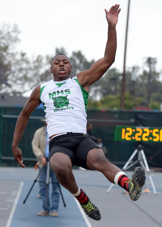 . Monrovia\'s Octavius Spencer competes in the Division 3 long jump during the CIF Southern Section track and final Championships at Cerritos College in Norwalk, Calif., Saturday, May 24, 2014.   (Keith Birmingham/Pasadena Star-News)