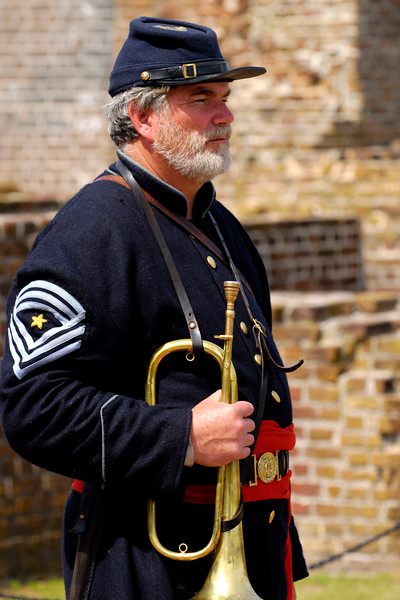 Reenactor Tom Smith, a principal musician bugler, stands inside Ft. Sumter during a reenactment of the surrender ceremony in Charleston, South Carolina on Thursday, April 14, 2011. ..The 150th Anniversary of the Firing on Ft. Sumter was commemorated with lectures, performances, demonstrations, and a living history throughout the area on James Island, Charleston, Mt. Pleasant, and Sullivan's Island during the week from April 8-14, 2011. Photo Copyright 2011 Jason Barnette