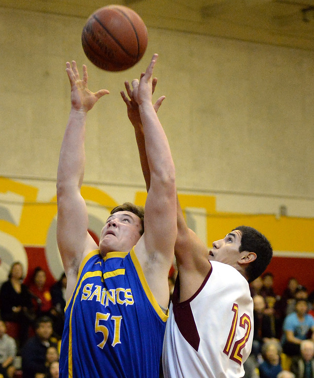 . San Dimas\' Josiah Erickson (51) reches for a rebound over Wilson\'s Anthony De Leon (12) in the first half of a prep basketball game at Wilson High School in Hacienda Heights, Calif., on Friday, Jan. 31, 2014. (Keith Birmingham Pasadena Star-News)