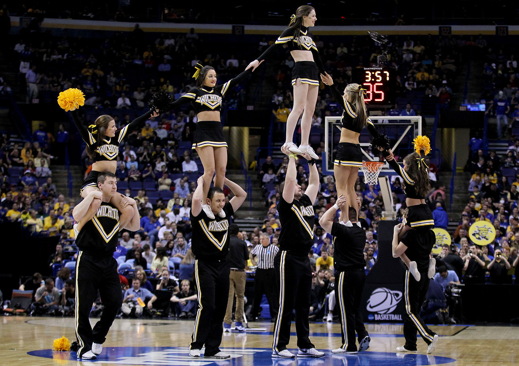 . Wichita State Shockers cheerleaders perform during the second round of the 2014 NCAA Men\'s Basketball Tournament against the Cal Poly Mustangs at the Scottrade Center on March 21, 2014 in St Louis, Missouri.  (Photo by Andy Lyons/Getty Images)