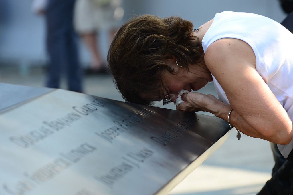 . Geraldine Davie of Pelham, New York cries after viewing name of her 23-year-old daughter Amy O\'Doherty, during ceremonies for the twelfth anniversary of the terrorist attacks on lower Manhattan at the World Trade Center site on September 11, 2013 in New York City.  (Photo by David Handschuh-Pool/Getty Images)