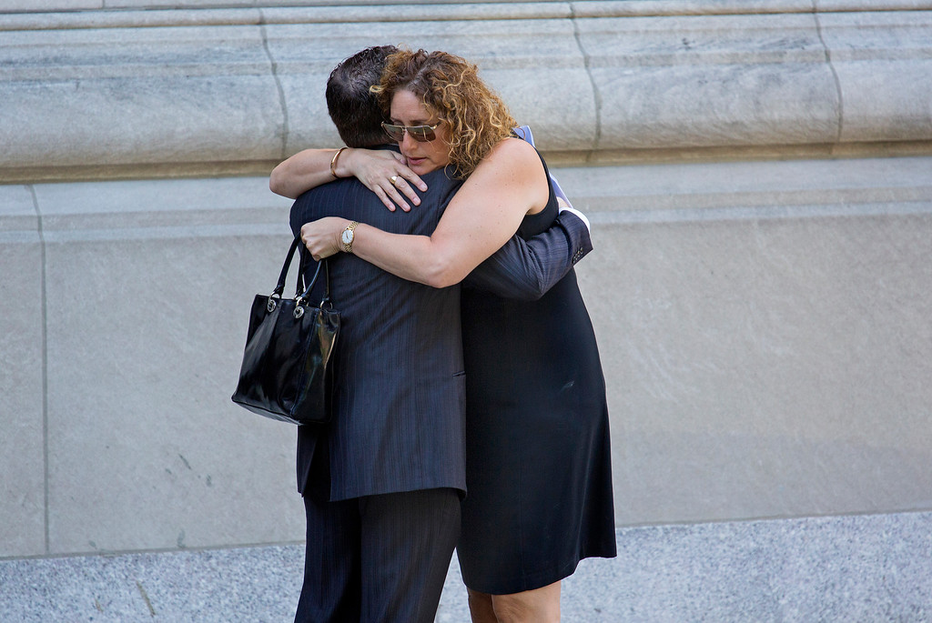 . Mourners embrace as they arrive at a funeral service for comedian Joan Rivers at Temple Emanu-El in New York Sunday, Sept. 7, 2014. Rivers died Thursday, Sept. 4, 2014. She was 81. (AP Photo/Craig Ruttle)
