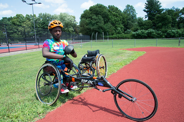 08/08/19 Wesley Bunnell | Staff Delmace Mayo prepares himself for the track and field event at the Hospital for Special Care's Ivan Lendl Adaptive Sports Camp at Berlin High School on Thursday August 9, 2019. Delmace is a member of the team which placed second at the Junior Nationals 2019 championship event in Minnesota.