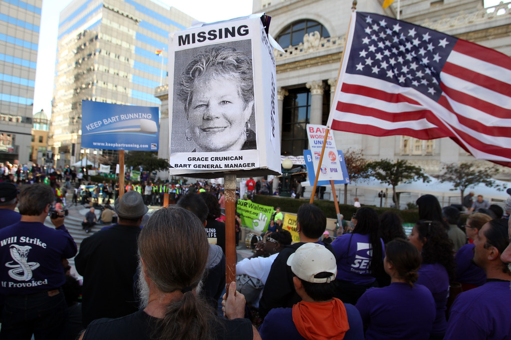 . An oversized poster of BART General Manager Grace Crunican outstands during a unions rally at Frank Ogawa Plaza in Oakland, Calif., on Thursday, Aug. 1, 2013. (Ray Chavez/Bay Area News Group)
