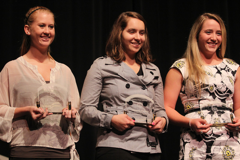 Students receive awards based on service and leadership.