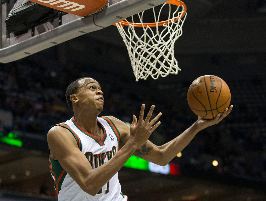 . Milwaukee Bucks\' John Henson lays the ball in against the Los Angeles Lakers during the second half of an NBA basketball game Thursday, March 27, 2014, in Milwaukee. (AP Photo/Tom Lynn)