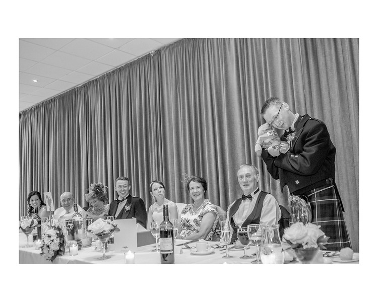 Wedding Photography of Susan & Ross, Barony Castle, Peebles Scotlnd, Photograph is of the top table with the Bestman speaking to Gordon the Gopher
