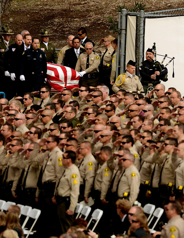 . The procession for San Bernardino County Sheriff Deputy Jeremiah MacKay enters the San Manuel Amphitheater in Devore February 21, 2013.  GABRIEL LUIS ACOSTA/STAFF PHOTOGRAPHER.