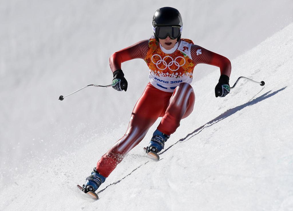 . Switzerland\'s Lara Gut makes a turn in the women\'s downhill at  the Sochi 2014 Winter Olympics, Wednesday, Feb. 12, 2014, in Krasnaya Polyana, Russia. (AP Photo/Luca Bruno)